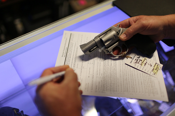Mark O'Connor fills out his Federal background check paperwork as he purchases a handgun at the K&W Gunworks store on the day that U.S. President Barack Obama in Washington, DC announced his executive action on guns on January 5, 2016 in Delray Beach, Florida.  (Photo by Joe Raedle/Getty Images)