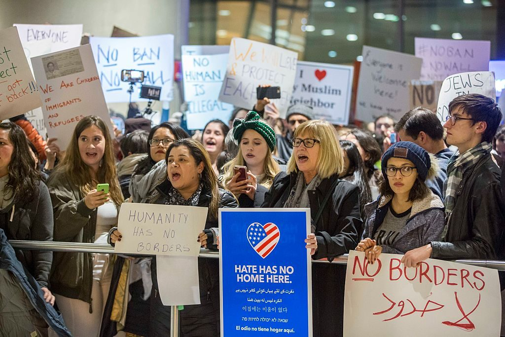 BOSTON, MA - JANUARY 28: Protestors rally at a demonstration against the new ban on immigration issued by President Donald Trump at Logan International Airport on January 28, 2017 in Boston, Massachusetts. President Trump signed an executive order that halted refugees and residents from predominantly Muslim countries from entering the United States. (Photo by Scott Eisen/Getty Images)