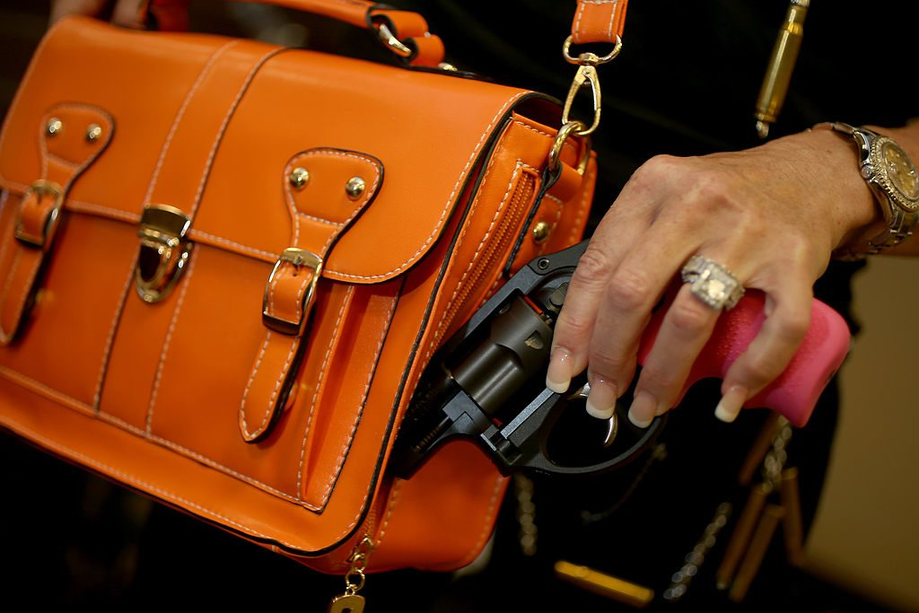 BOCA RATON, FL - OCTOBER 21:  Susan Kushlin poses with a concealed-carry handbag that her company, Gun Girls, Inc., created for women that enjoy guns. (Photo by Joe Raedle/Getty Images)