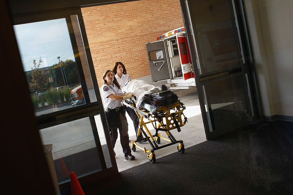 Paramedics bring an injured child into the emergency room of the non-profit Children's Hospital on September 14, 2009 in Aurora, Colorado. (Photo by John Moore/Getty Images)